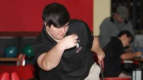 East Islip's Joe Carroll bowls during a Suffolk