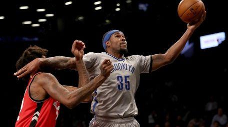 Trevor Booker #35 of the Brooklyn Nets heads