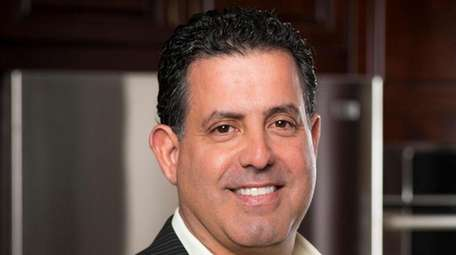 Salvatore Ferro, of Commack, president and CEO of