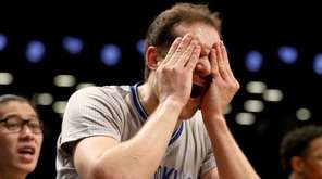 Bojan Bogdanovic #44 of the Brooklyn Nets reacts
