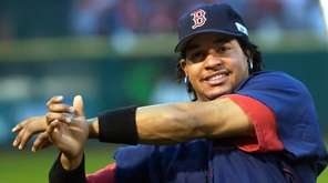 Boston Red Sox outfielder Manny Ramirez stretches before