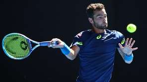 Noah Rubin plays a forehand in his second-round