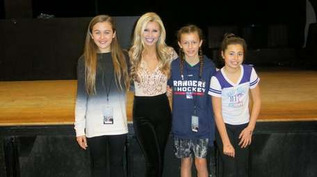 Singer Tiffany Houghton with Kidsday reporters Sophia Wennerod,