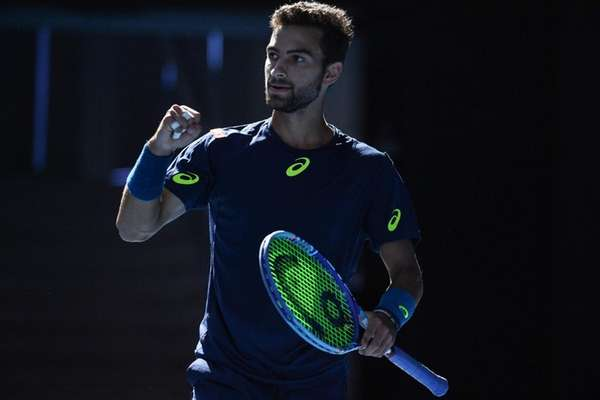 Noah Rubin reacts after a point against Roger