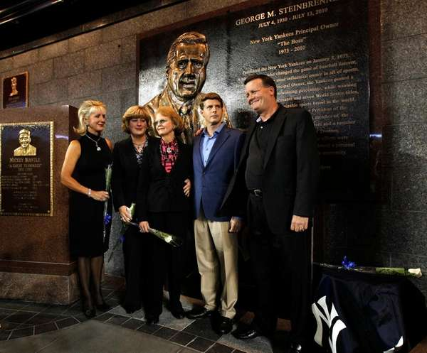 Members of George Steinbrenner's family pose for photographers