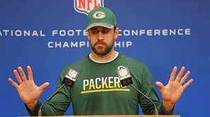 Green Bay Packers quarterback Aaron Rodgers speaks with