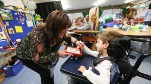 Special education teacher Cathy Faithfull works with Julian