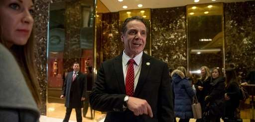 New York Gov. Andrew Cuomo, center, accompanied by