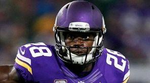 Minnesota Vikings running back Adrian Peterson carries the