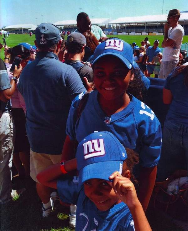 Kidsday reporter Sarai Alleyne, top, with her sister