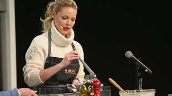 Actress Katherine Heigl cooks on stage during the