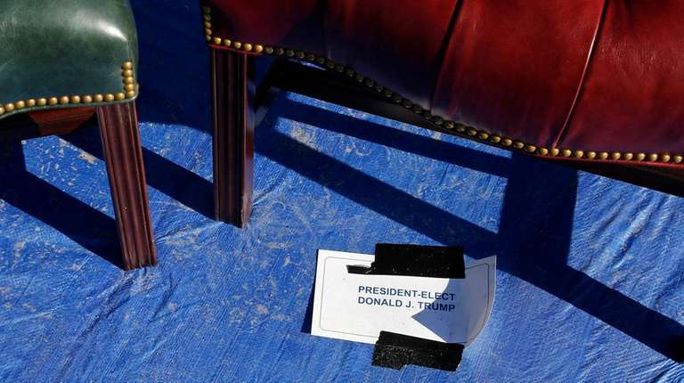 A sign is posted onstage beneath a chair