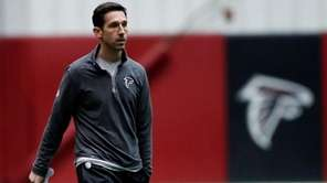 Atlanta Falcons offensive coordinator Kyle Shanahan walks on