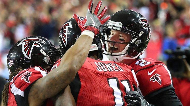 Atlanta Falcons quarterback Matt Ryan, right, and running