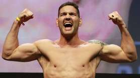Chris Weidman reacts during UFC 205 weigh-ins at
