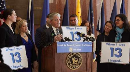 Suffolk County Executive Steve Bellone, center, announced an