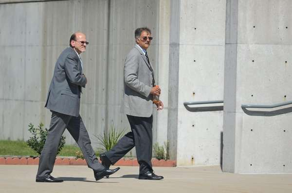 Dennis Halstead, left, and John Restivo walk into