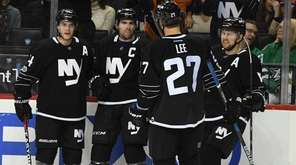 New York Islanders center John Tavares and teammates
