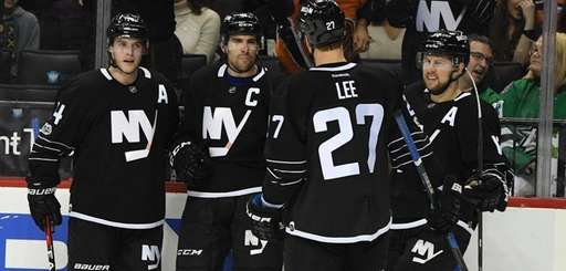 New York Islanders center John Tavares and teammates