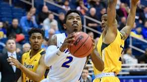 Hofstra Pride guard Deron Powers drives on Towson