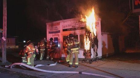 Investigators from the Suffolk County police arson squad