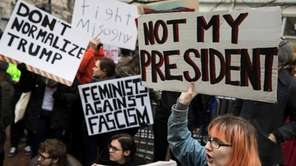 Demonstrators protest before the inauguration of President-elect Donald