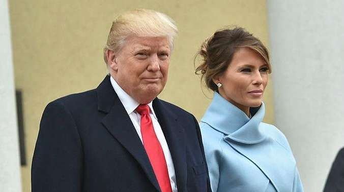 President-elect Donald Trump and his wife Melania walk