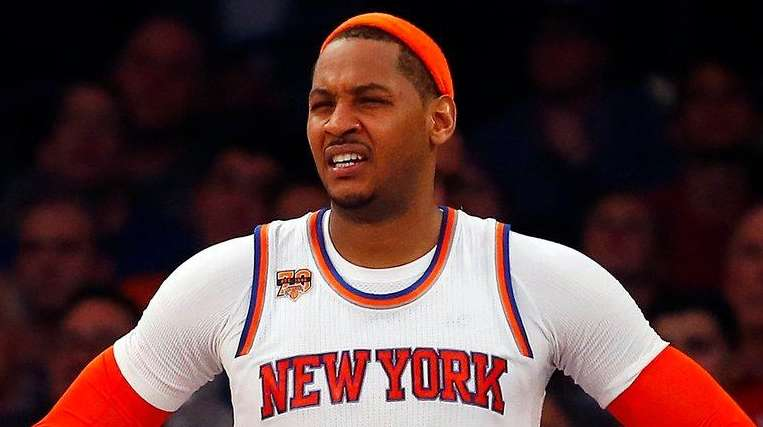 The Knicks' Carmelo reacts in the fourth quarter