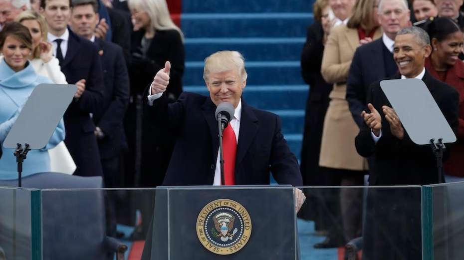 President Donald Trump gives a thumbs after being