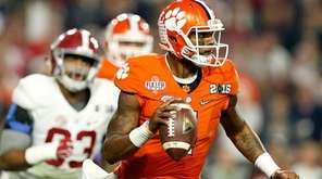 Deshaun Watson of the Clemson Tigers looks to throw
