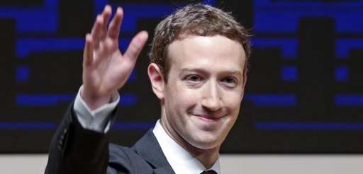 Mark Zuckerberg, chairman and CEO of Facebook, waves