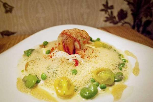 Butter poached lobster is served with creamy polenta,
