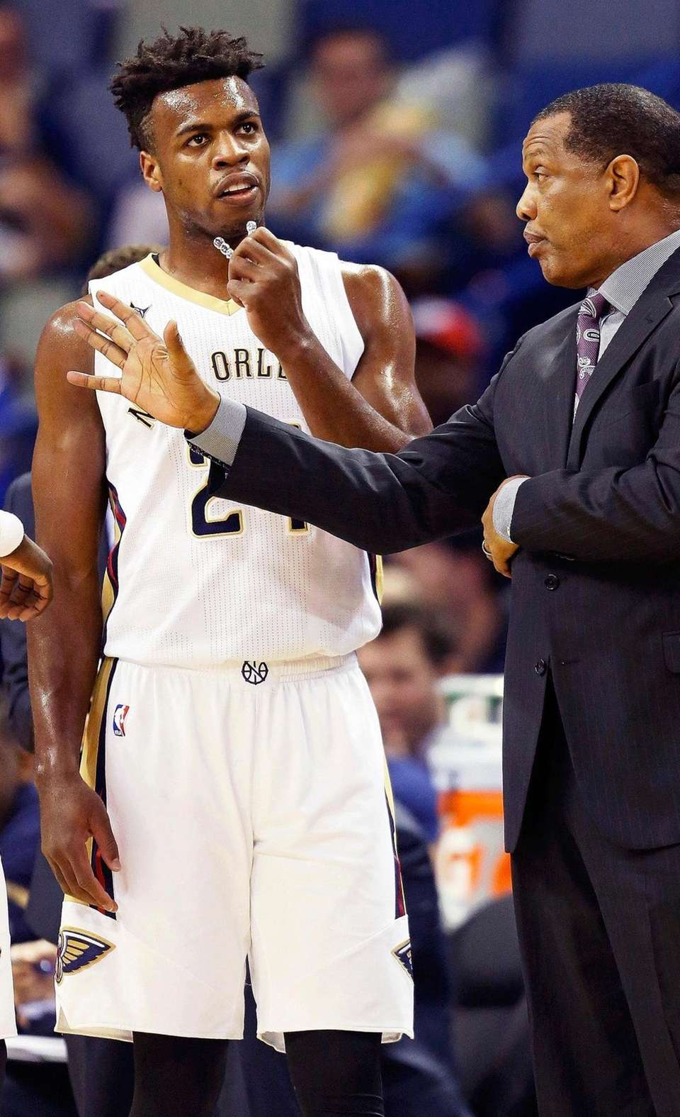 New Orleans Pelicans coach Alvin Gentry, right, talks