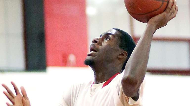 Freeport's Rollin Bell slams for two during the