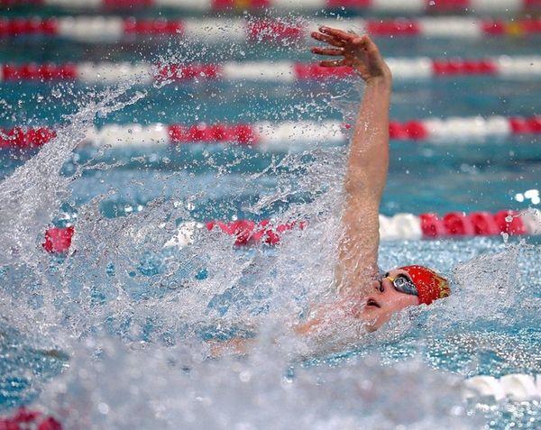 Sachem's Nicholas Neri swims in the bonus heat