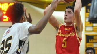 Michael O'Connell #5 , Chaminade freshman, right, pulls