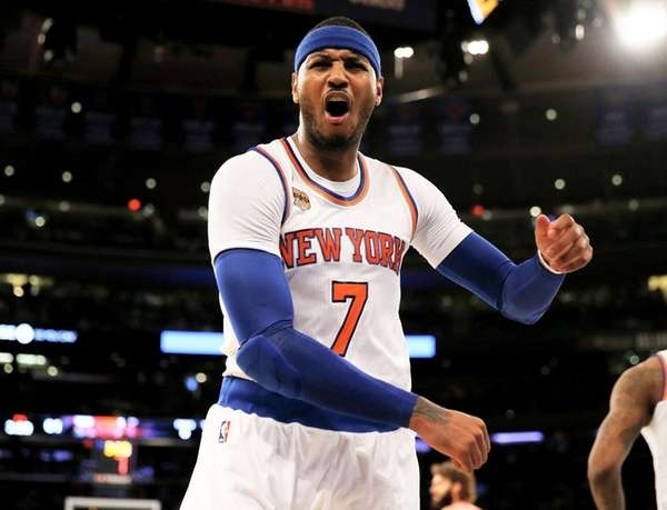The Knicks' Carmelo Anthony is called for a