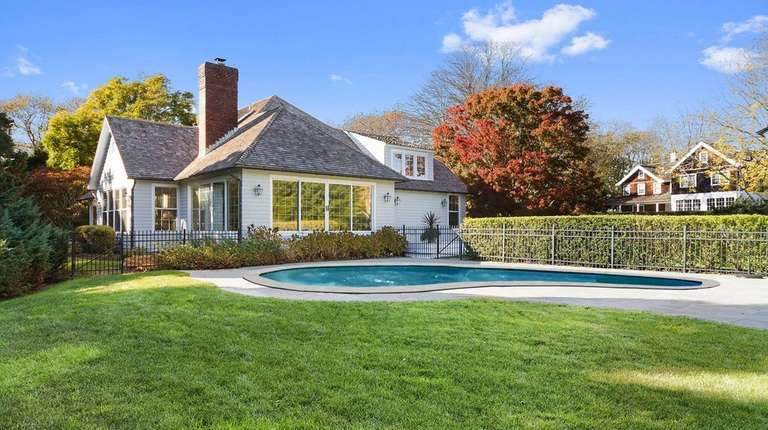 The property includes a free-form shaped gunite pool.
