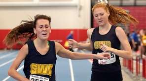 Shoeham-Wading River's Payton Capes-Davis (l) crosses the line