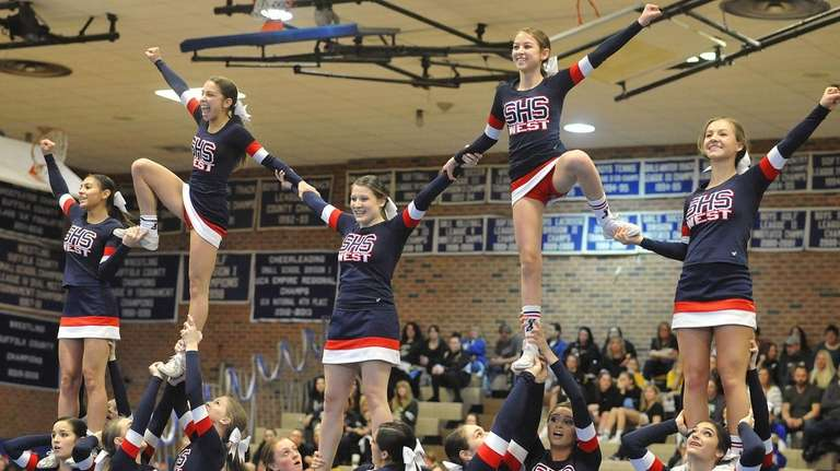 The Smithtown West varsity cheerleaders perform during a