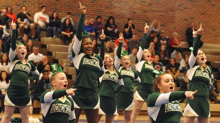 The Longwood varsity cheerleaders perform during a competition