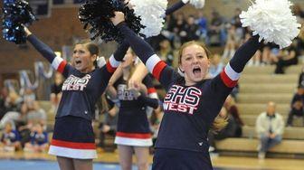 Hannah Johnson and Smithtown West varsity cheerleaders perform