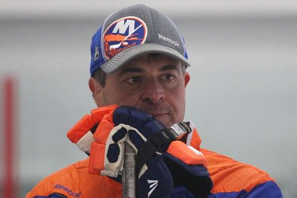 Jack Capuano looks on during Islanders practice at