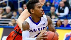 Hofstra Pride guard Deron Powers drives past Northeastern
