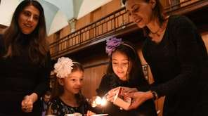 Marta Humbertstone, right, and her daughters Isabella, 8,