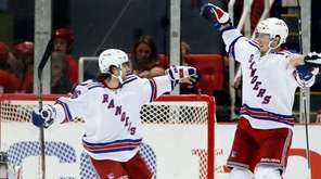 New York Rangers' J.T. Miller, right, celebrates with