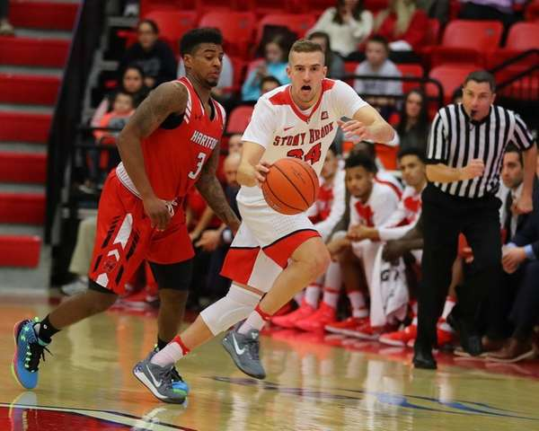 Stony Brook's Lucas Woodhouse #34 moves the ball