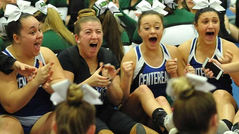 The Centereach cheerleading squad reacts after winning an
