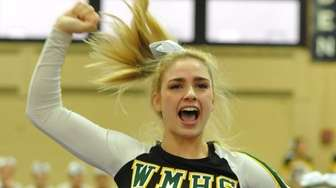The Ward Melville cheerleading squad performs during an