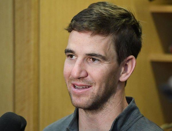 New York Giants quarterback Eli Manning speaks to